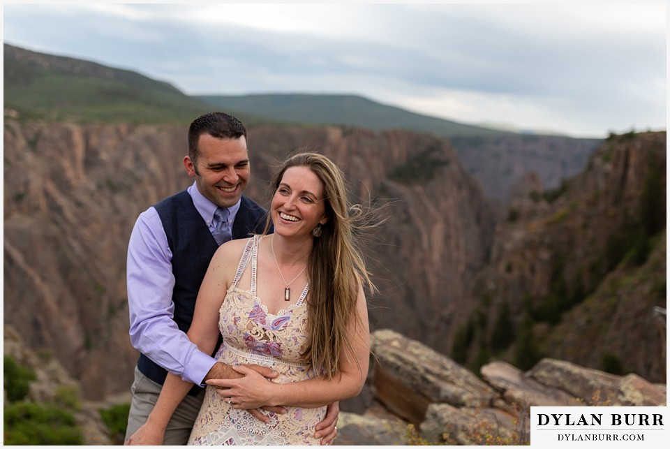 black canyon colorado elopement wedding adventure bride and groom stopping for a laugh