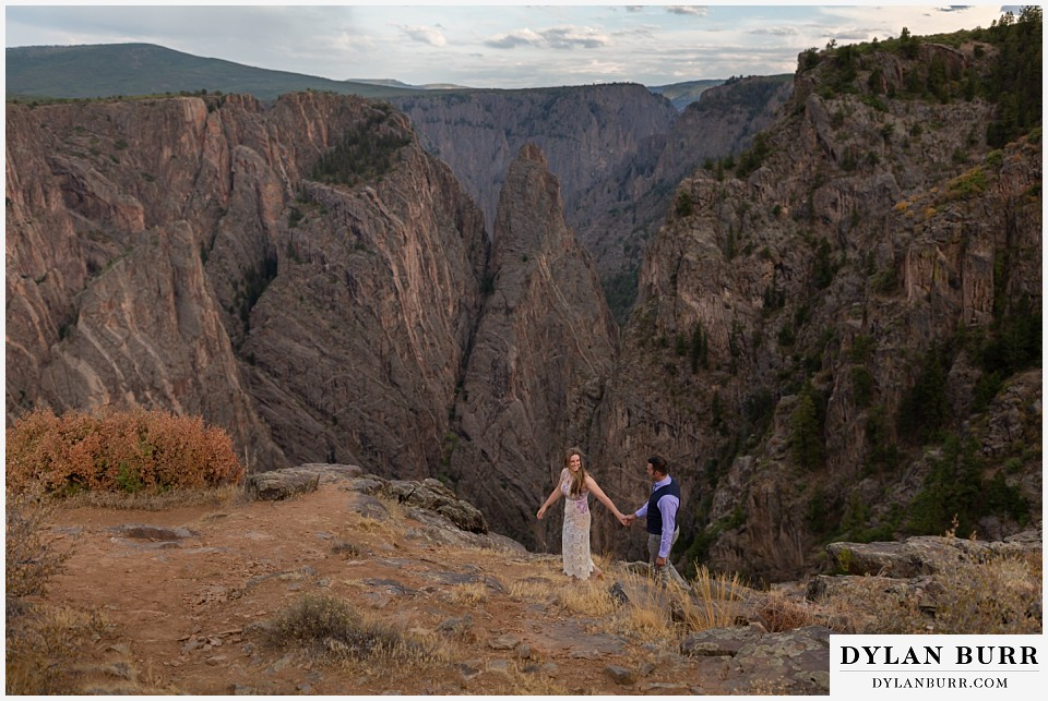 black canyon colorado elopement wedding adventure bride and groom walking along canyon wall
