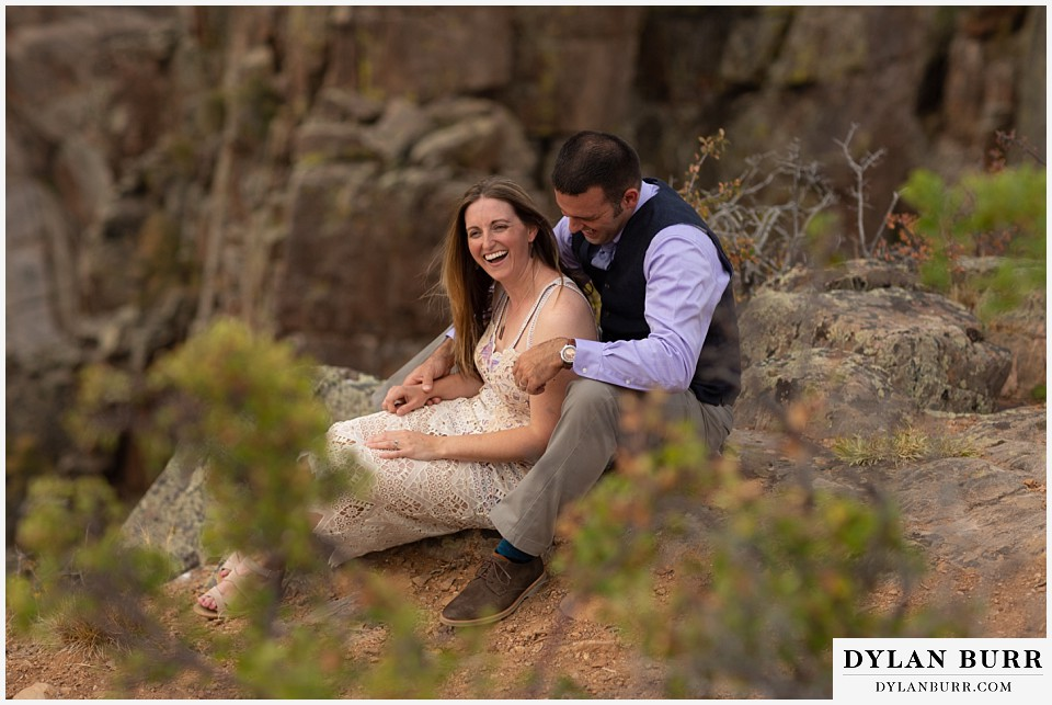 black canyon colorado elopement wedding adventure bride and groom laughing together near the canyon ledge