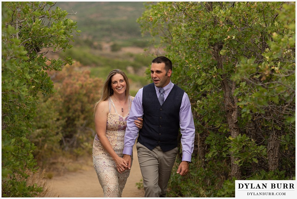 black canyon colorado elopement wedding adventure bride and groom walking together in scrub gambel oak trees.