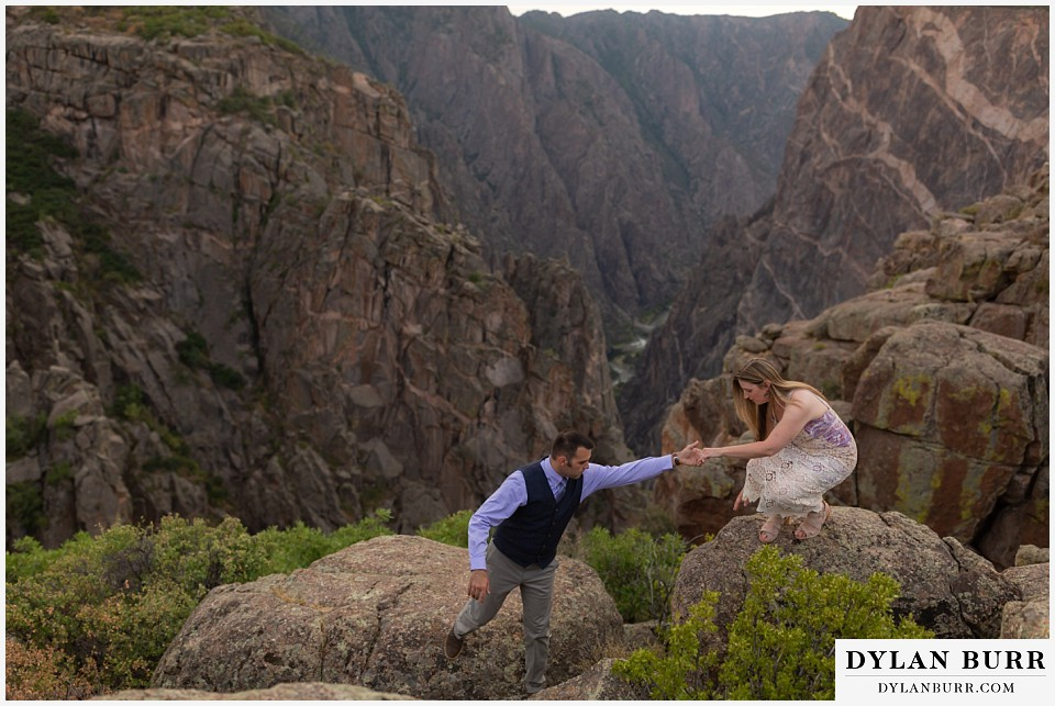 black canyon colorado elopement wedding adventure bride and groom hiking on rocks