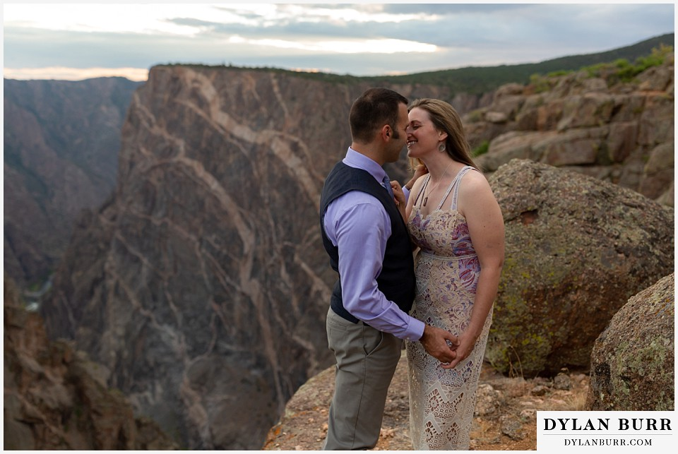 black canyon colorado elopement wedding adventure bride and groom kiss near the painted wall