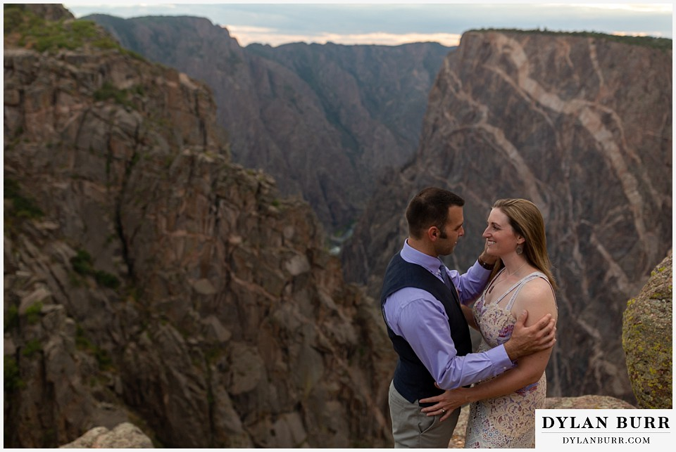 black canyon colorado elopement wedding adventure bride and groom share a moment near the painted wall at sunset