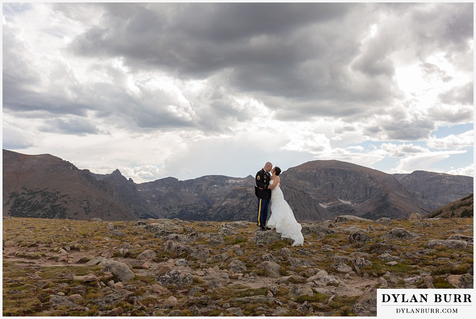 rocky mountain national park wedding colorado bride and groom kissing on top of mountain range