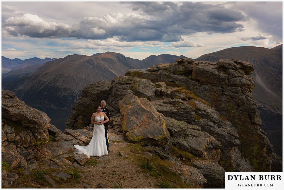 rocky mountain national park wedding bride and groom in rocks on the top of the mountains