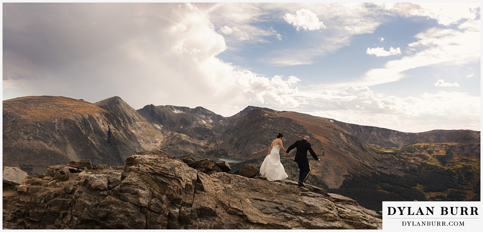 rocky mountain national park wedding colorado bride and groom hiking on top of the mountains