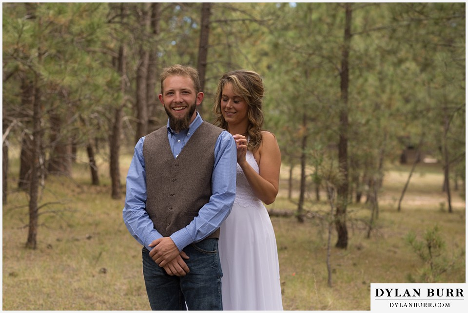 boho backyard colorado wedding excited groom to see wife