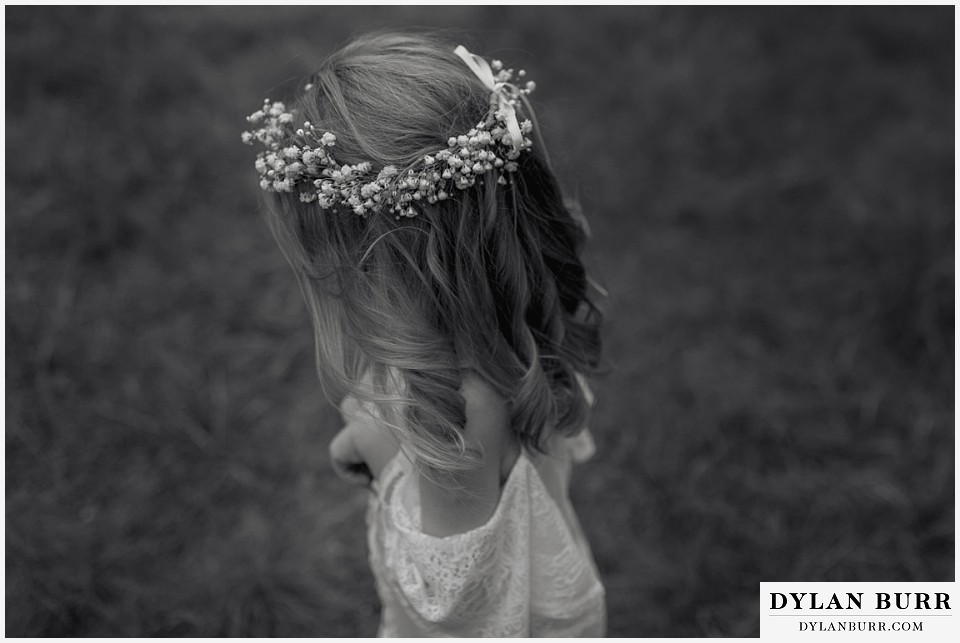 boho backyard colorado wedding black and white photo of little girls flower crown