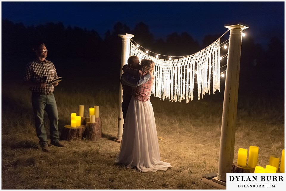 boho backyard colorado wedding bride and grooms first kiss as husband and wife
