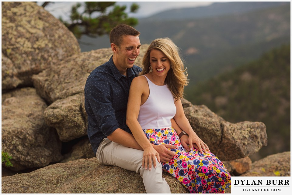 boulder sunset engagement session laughing on rock