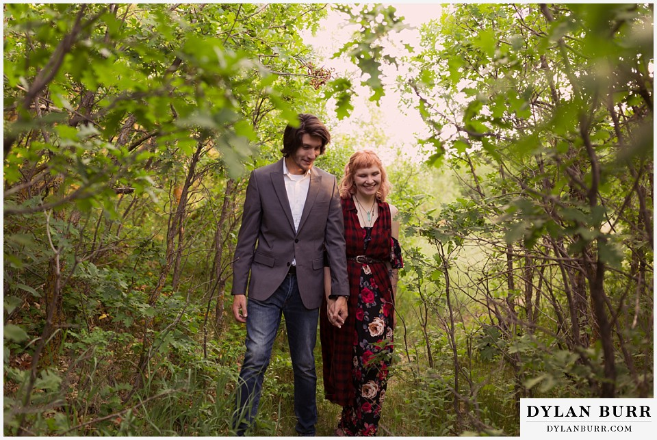 castle rock colorado engagement session walking in tight tree lined trail