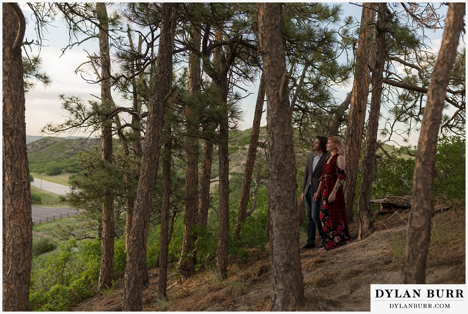 castle rock colorado engagement session watching sunset in pine trees