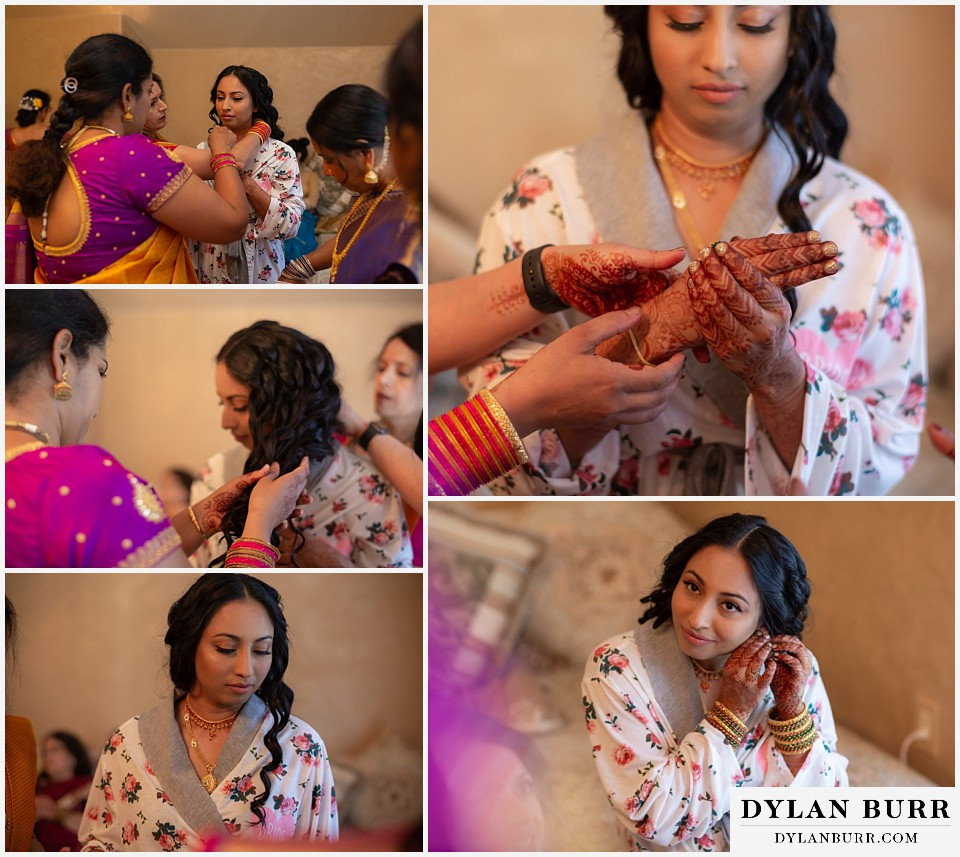 cielo at castle pines wedding colorado mountain wedding bride with henna on hands putting jewelry on