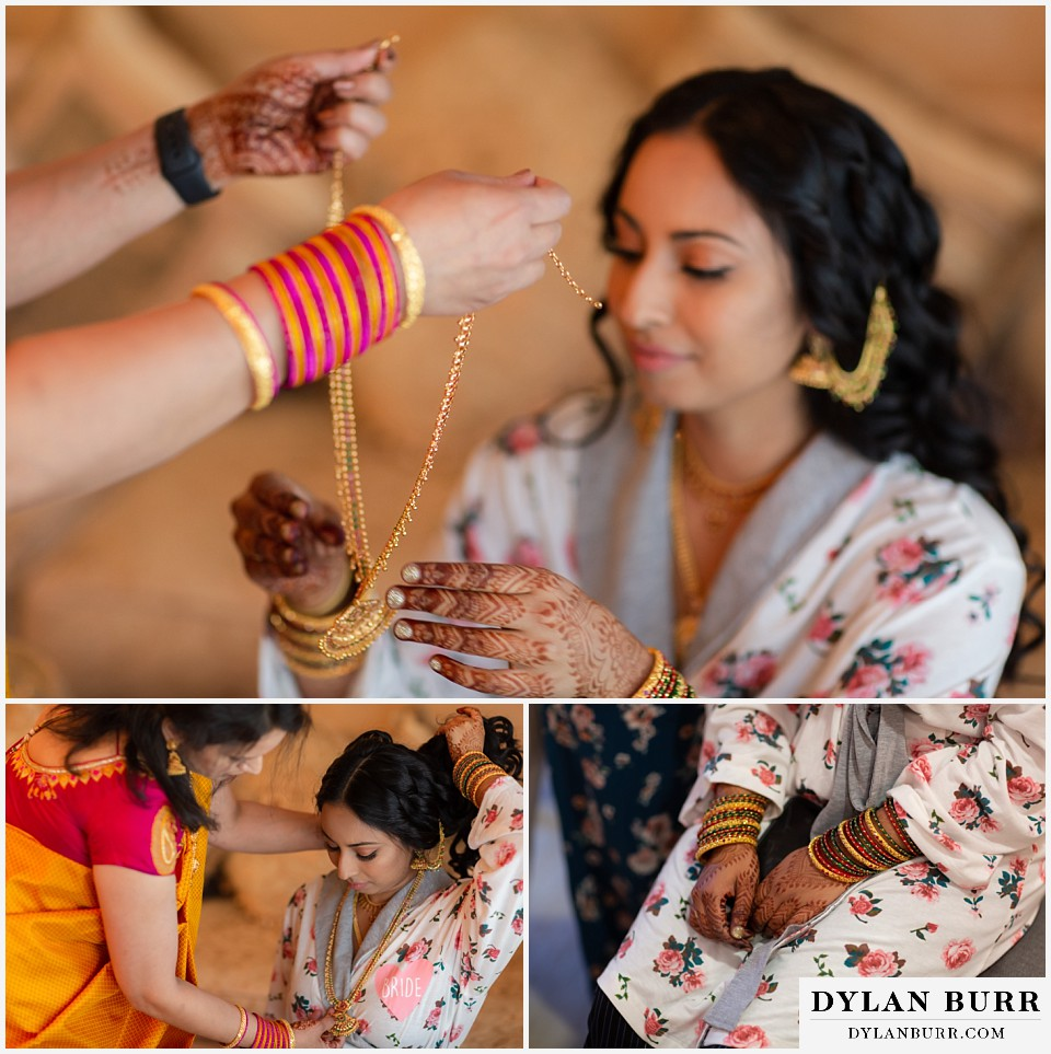 cielo at castle pines wedding colorado mountain wedding bride putting on necklace henna hands and bangles