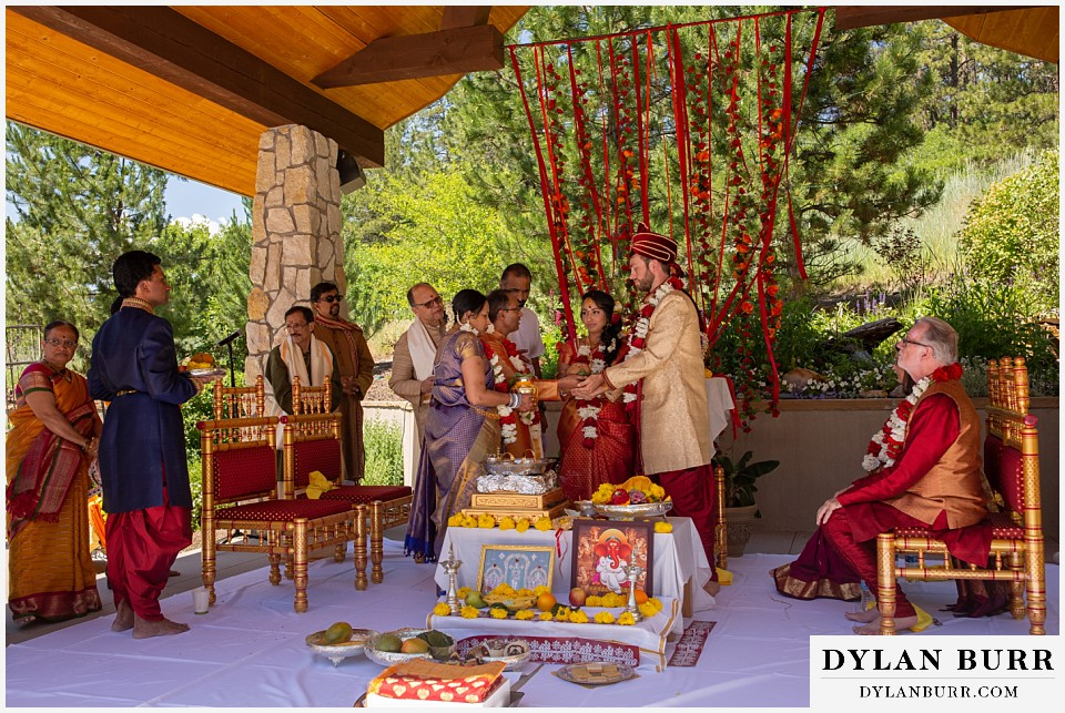 cielo at castle pines wedding colorado mountain wedding groom and brides family together hindu ceremony