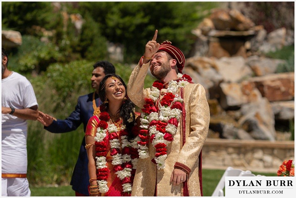 cielo at castle pines wedding colorado mountain wedding groom picking a star in the sky with bride hindu ceremony