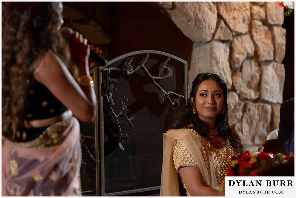 cielo at castle pines wedding colorado mountain wedding hindu bride looking on at maid of honor toast during reception