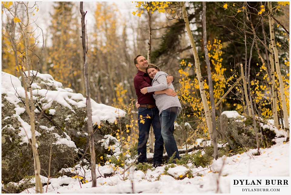 colorado mountain engagement session sharing a sweet moment and a hug