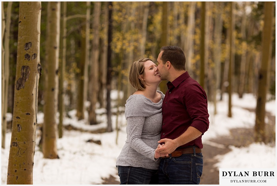 colorado mountain engagement session aspen trees kissing