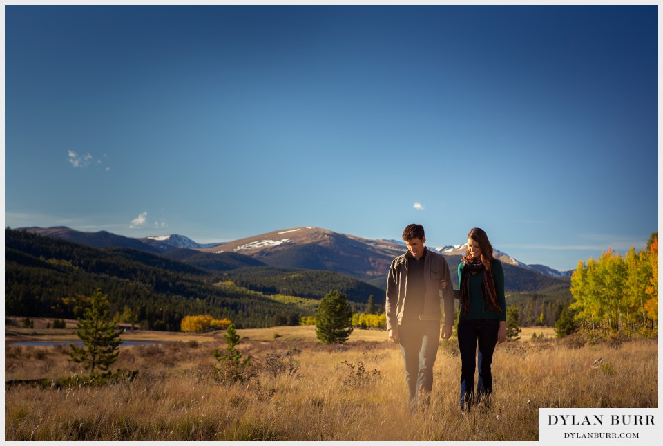 fall colorado engagement photos mountains snow capped