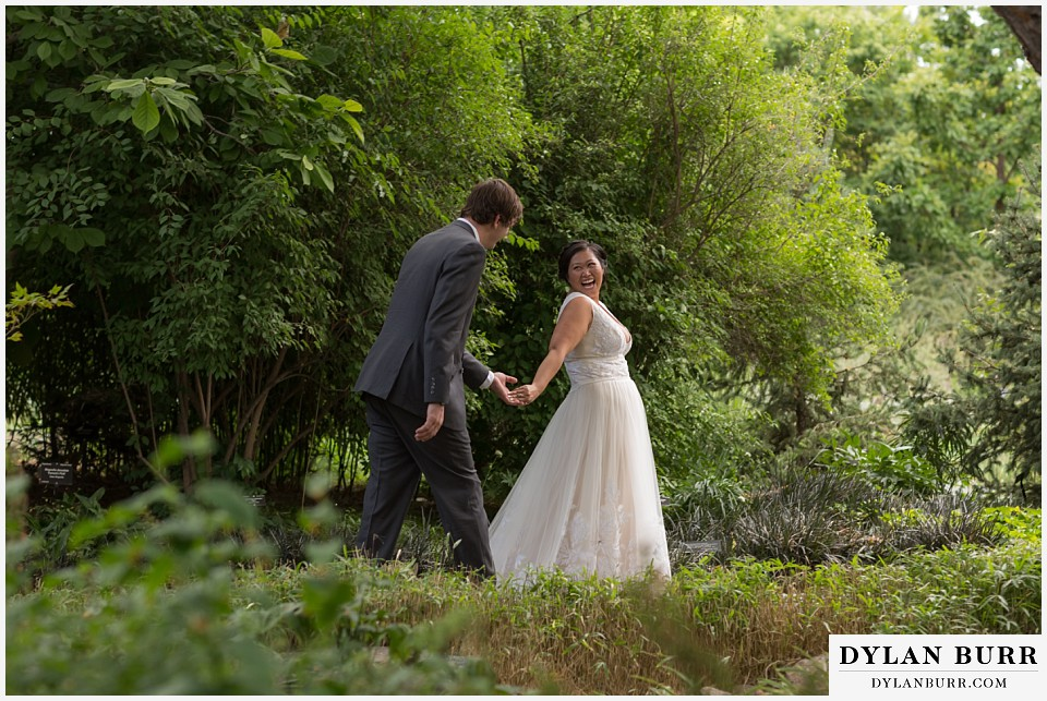 denver botanic gardens wedding colorado woodland mosaic bride groom laughing and walking together
