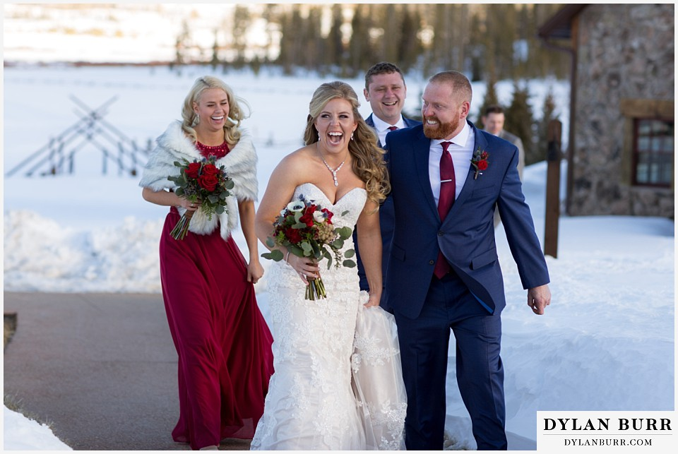 devils thumb ranch wedding in winter bridal party walking in snow