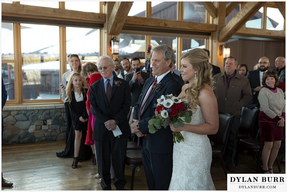devils thumb ranch wedding in winter ceremony timber house bride
