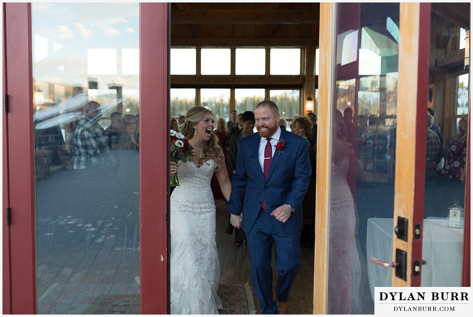 devils thumb ranch wedding in winter ceremony timber house happy