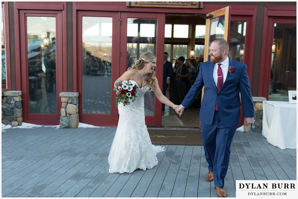 devils thumb ranch wedding in winter ceremony timber house laughing