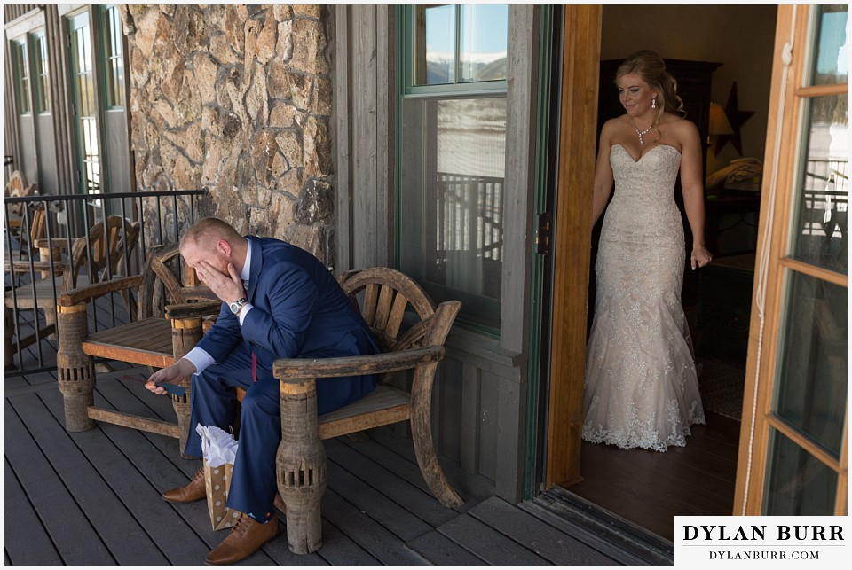devils thumb ranch wedding in winter first look bride watching