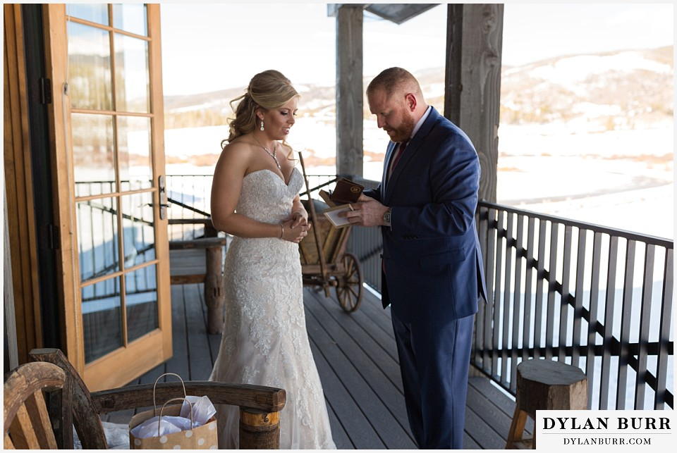 devils thumb ranch wedding in winter first look grooms gift