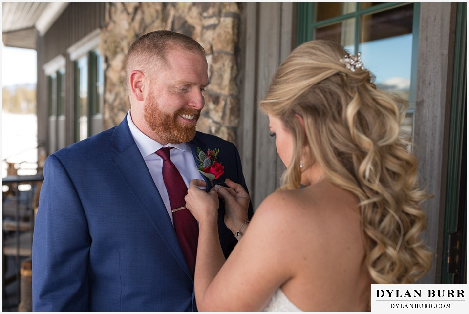 devils thumb ranch wedding in winter grooms boutineer