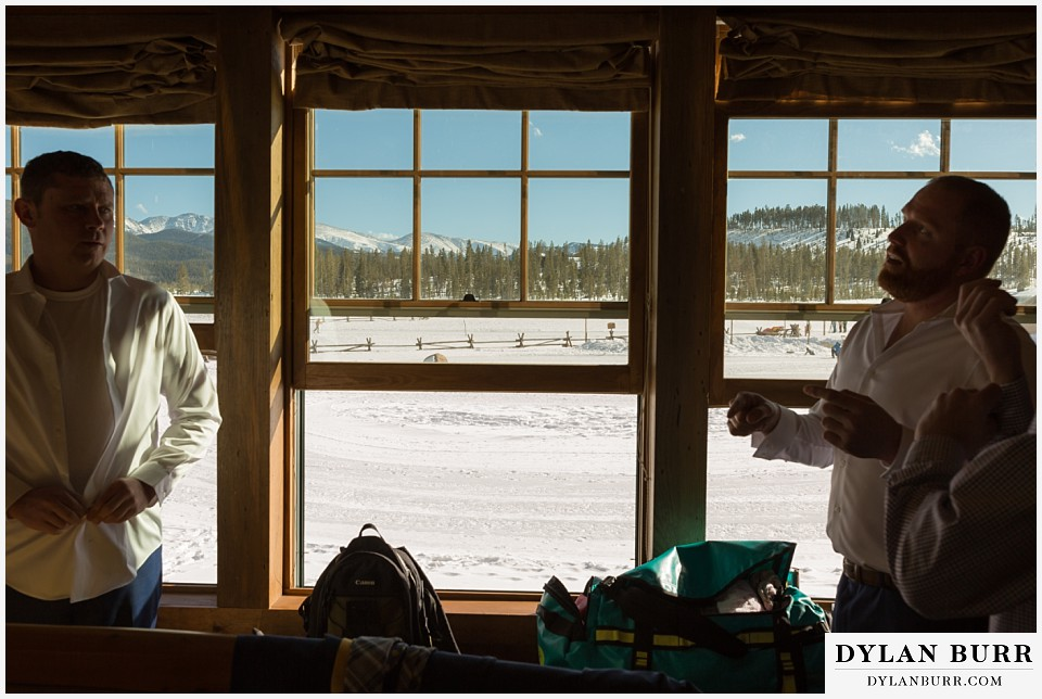 devils thumb ranch wedding in winter groomsmen getting ready lodge cabin
