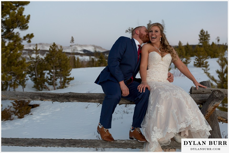 devils thumb ranch wedding in winter newlyweds having fun