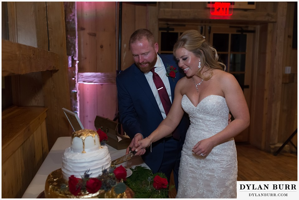 devils thumb ranch wedding in winter reception cake cutting
