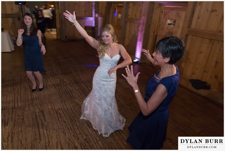 devils thumb ranch wedding in winter reception party bride dancing