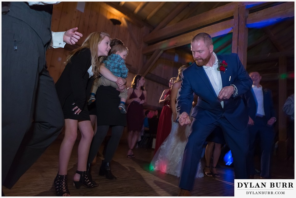 devils thumb ranch wedding in winter reception party funny groom