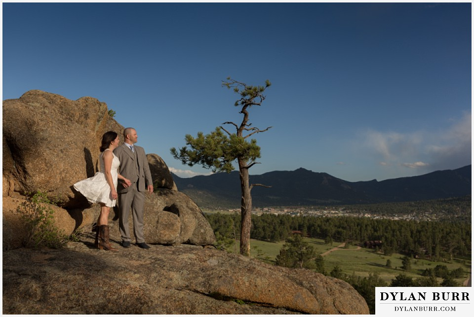 rocky mountain estes park engagement session view of Estes Park and surrounding mountains on large rocks
