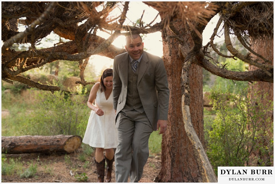 rocky mountain estes park engagement session exploring under giant pine tree