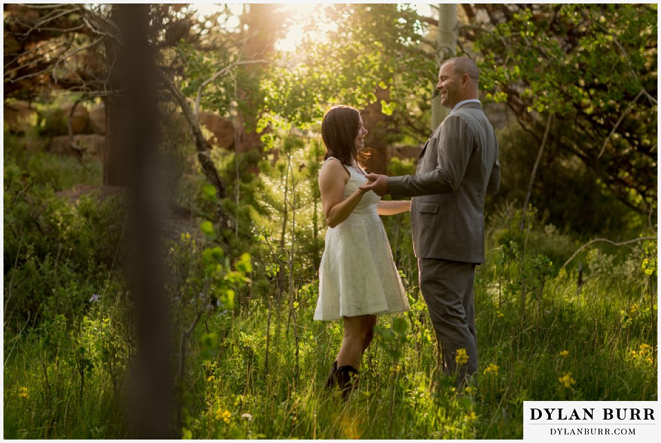 rocky mountain estes park engagement session standing in meadow with aspen trees