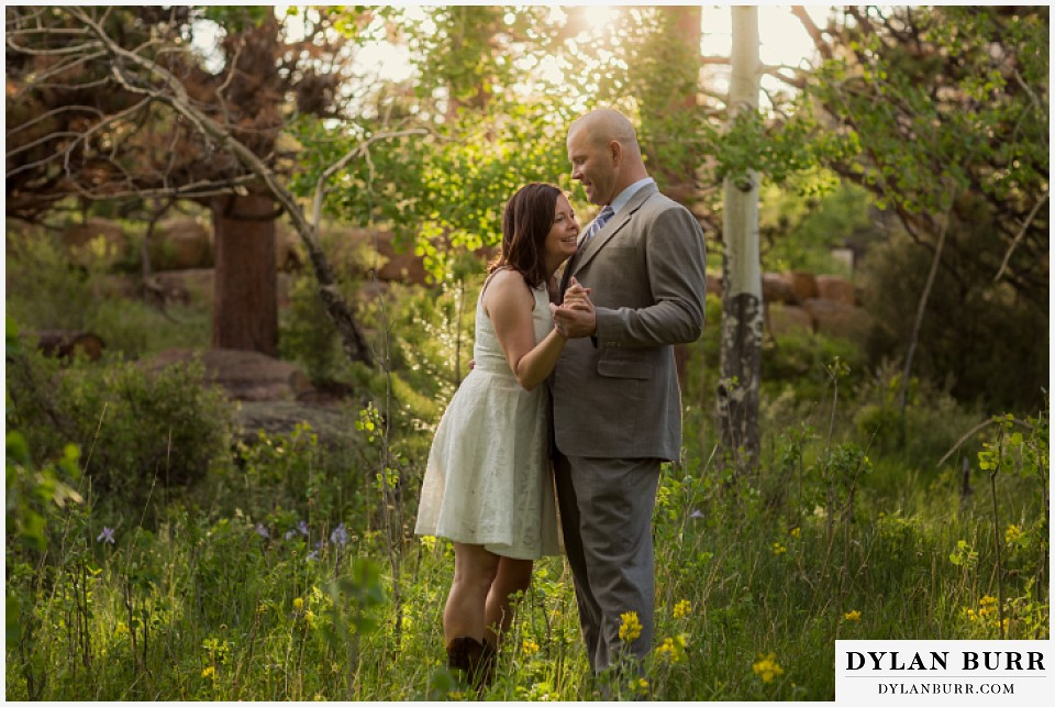rocky mountain estes park engagement session holding eachother in meadow