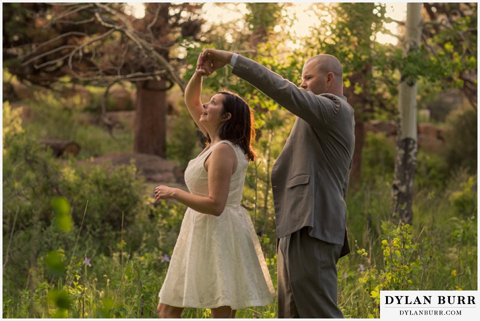 rocky mountain estes park engagement session dancing together in meadow