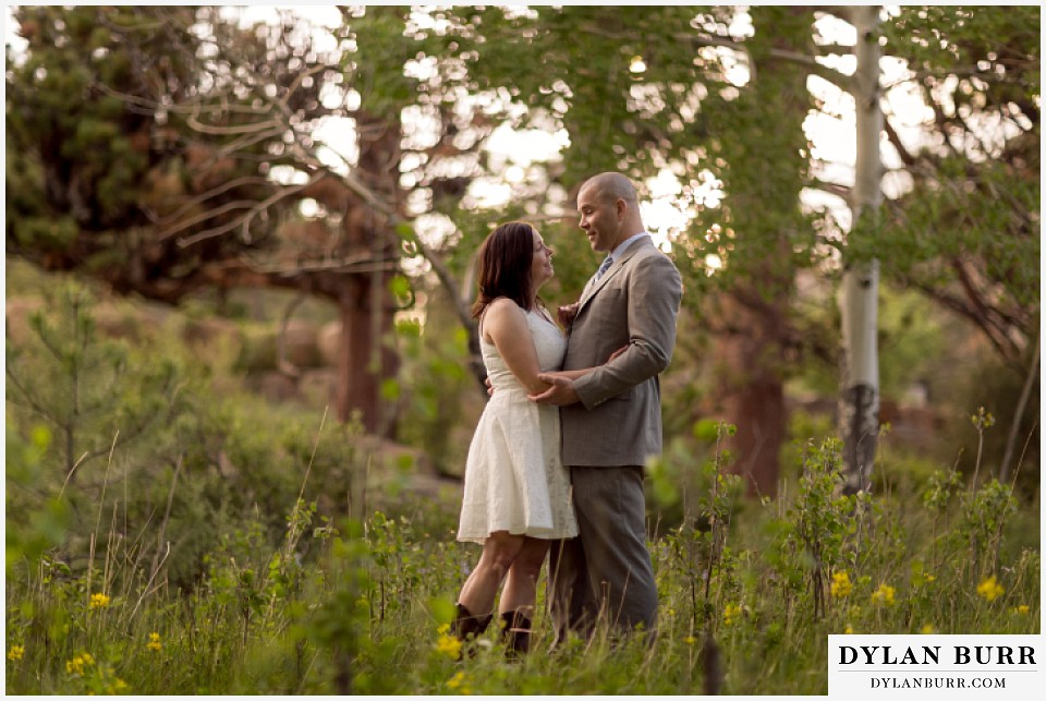 rocky mountain estes park engagement session standing together in a meadow of aspen trees