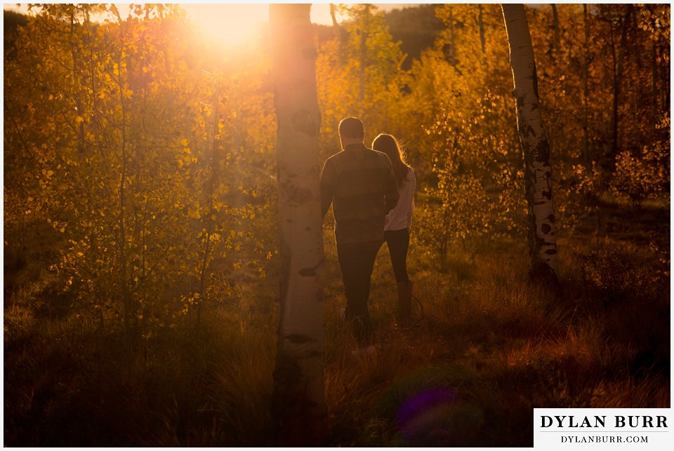 colorado mountains fall engagement photo session walking at sunset