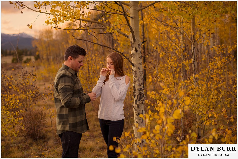 colorado mountains fall engagement photo session playing together