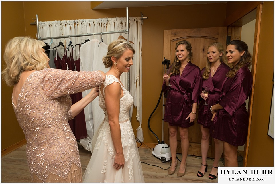 the lodge at sunspot wedding winter park bride in wedding dress getting ready