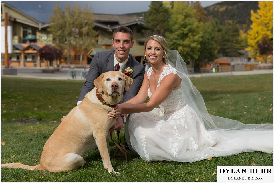 the lodge at sunspot wedding winter park couple with dog