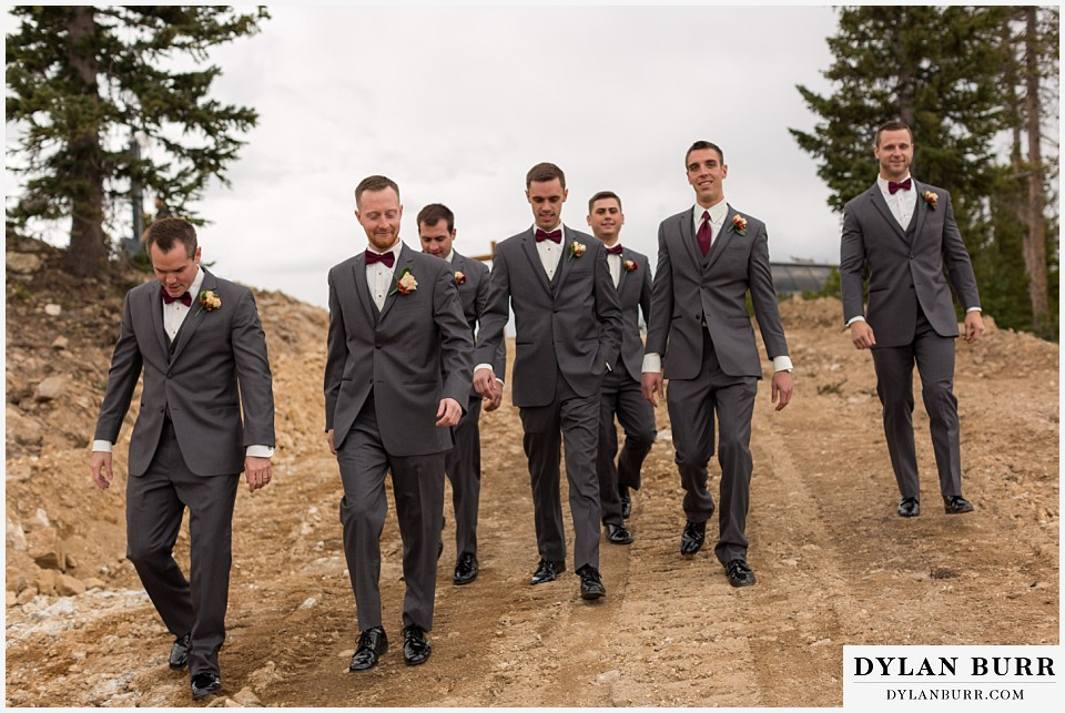 the lodge at sunspot wedding winter park groomsmen walking