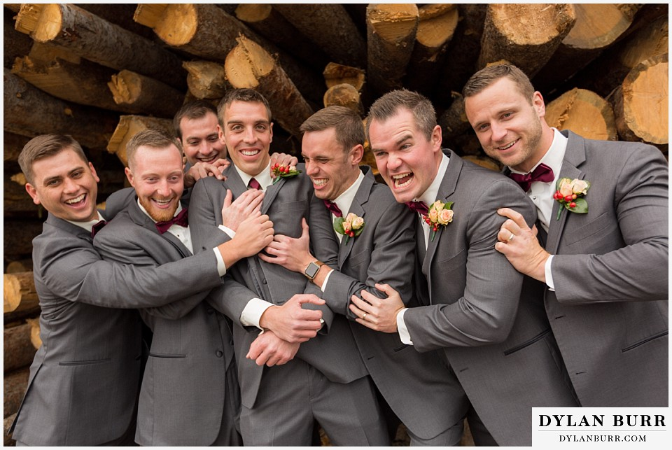 the lodge at sunspot wedding winter park groomsmen having fun