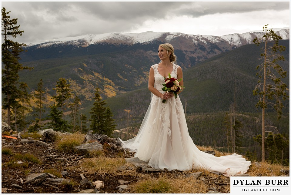 the lodge at sunspot wedding winter park bride on top of mountain